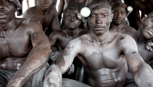 Enslaved gold miners in Ghana, bound by illegal, fictitious debt. Photography: Lisa Kristine